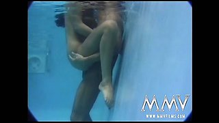 Hot brunette having erotic moist sex in the pool