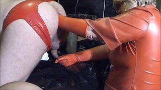 Red latex Fist for the Anal Slave