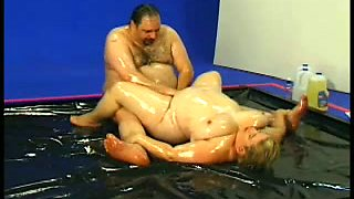 A fat man and white blonde BBW bitch wrestling all greasy