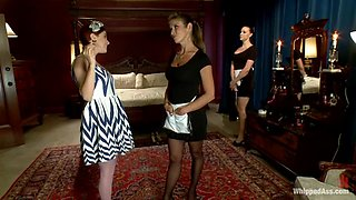 Redhead girl gets punished and toyed by two housemaids