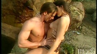 Explorer babe meets a hunk in the jungle and fucks him outdoors