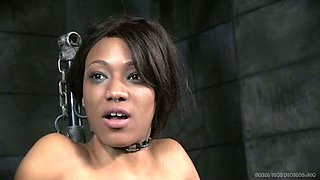 Sexy ebony slave with nipple clamps gets her pussy toyed