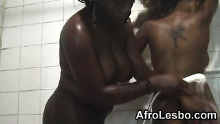 African lesbians Yvonne and Simone have pussy fun in the bathroom