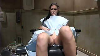 Busty brunette Krissy Kage takes a hot ride on a fucking machine