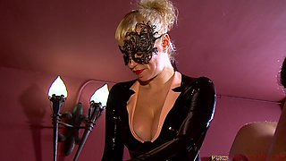 Latex mistresses Lady Patricia and Anna abuse their male slave's dick