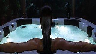 Denise Richards looking sexy in a black bikini as she