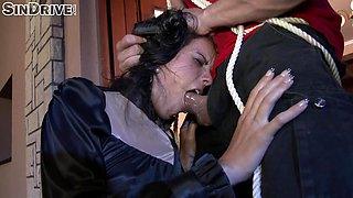 Tied up brunette chick forced to suck a massive cock