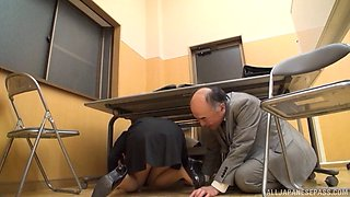 Old Asian guy climbs under the desk to eat secretary ass