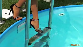 domina makes two babes wrestle in swimming pool