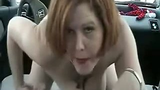 Redhead playful milf in my car fucking the gear stick