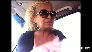Bosomy blonde granny gives me a good handjob in a car