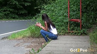 Hot brunette teen babe is smoking and pissing on the bus station