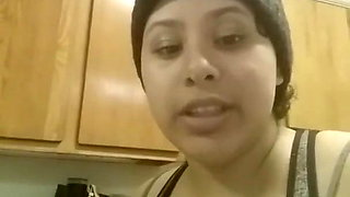Busty Latina squeezing milk out of her tit at home