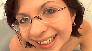 Hussy brunette wearing glasses gives her head and enjoys pee
