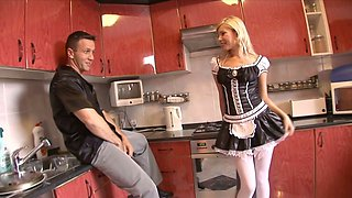Blonde in stockings and maid uniform Donna Bell polishes a big dick