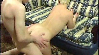 Tenacious blonde swallows a load of cum after spirited humping on the couch