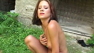 Funky brunette babe with big tits gets banged by fucking machine outdoors