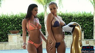 Two big boobs hotties play with each other in the pool