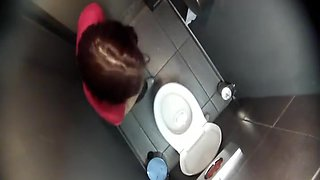 Filming her from a toilet ceiling