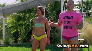 Swinger couples get together by the pool to play hot and kinky games