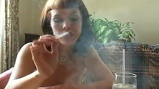 Sensual brunette is smoking and talking dirty