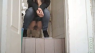Hot young brunette girl in jeans shows her pussy in the toilet