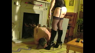 MadamSx in boots & stockings.