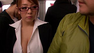 Busty Japanese babe in glasses giving a tit job in public
