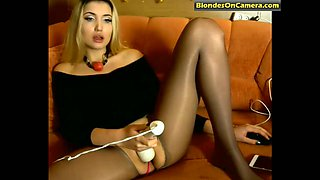 blonde girl in pantyhose with cut hole fucks her pussy
