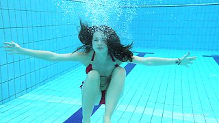 Fascinating view of solo model Russian teen nice ass in pool