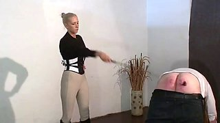 slave gets caned by strict blonde mistress