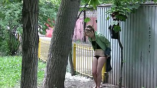 Cute and petite Russian chick changes clothes outside
