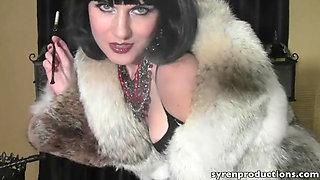 Beautiful slut smoking in a fur coat