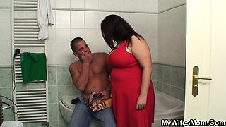 Big boobs mom riding his cock in the bathroom