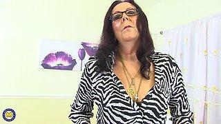 Brunette granny in glasses Zadi inserts toys in her pussy