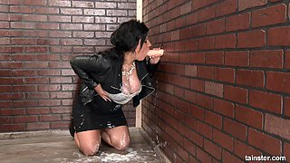 Chick in a leather jacket engages in a messy gloryhole adventure