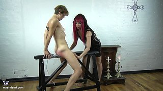Mature redhead mistress abuses her mature blonde slave with wax