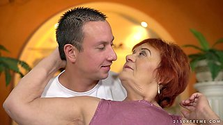 Wrinkled pallid old redhead Marsha is good at riding fat cock
