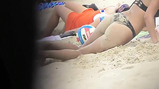 Drunk blond girl gets dirty on beach