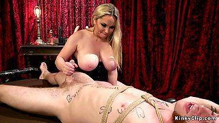 Huge tits dominatrix wanks off subs dick
