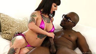Tattooed hooker Dollie Darko guarantees you an unforgettable pleasure