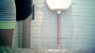Pale skin brunette sweetheart in the toilet room caught on voyeur video