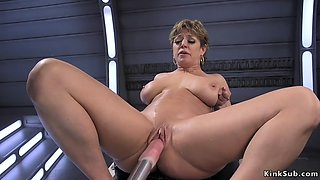 Milf rides dildos before fucking machine