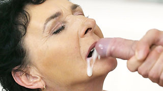 Granny maid takes a facial cumshot