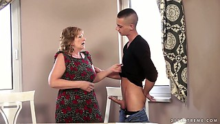 Horny granny Sally G fucks a handsome student on the couch