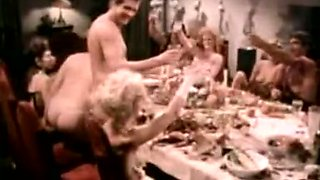 Wild ten people orgy and swinger party on the dinner table