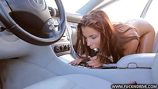 sexy redhead masturbates in a car with the helpf of a stick shift handle