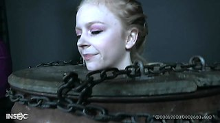 Victoria Voxxx tied up with her hands above her head and abused