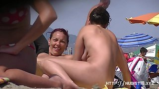 Nice women sunbathing on beach in France spy video