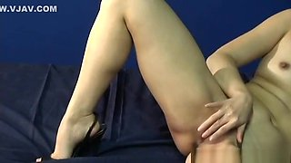 Lovely Korean babe plays with her wet pussy